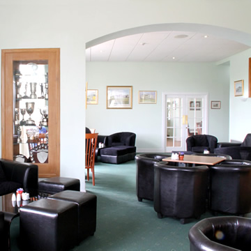 View of the sitting area and trophy cabinet in the Drumoig Golf Hotel