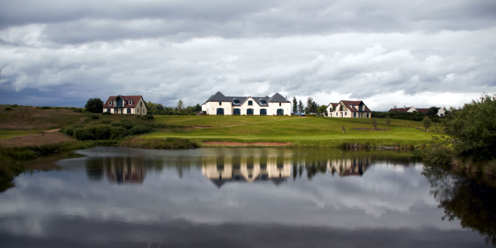 View of the hotel from the golf course lochs
