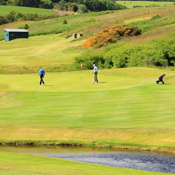 Golfers on the eighteenth green Drumoig Golf Course