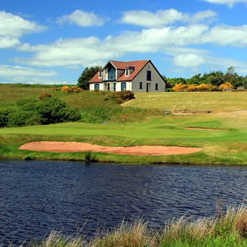View of loch, eighteenth green and lodge on the Drumoig Golf Course