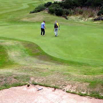 Golfers on the fifth green Drumoig Golf Course